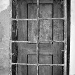 door behind bars
