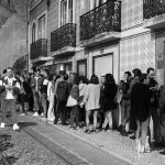 crowd on Irreal' sidewalk